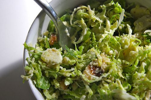 I love this salad: raw brussels sprouts, walnuts, parmesan cheese, with a dijon dressing.