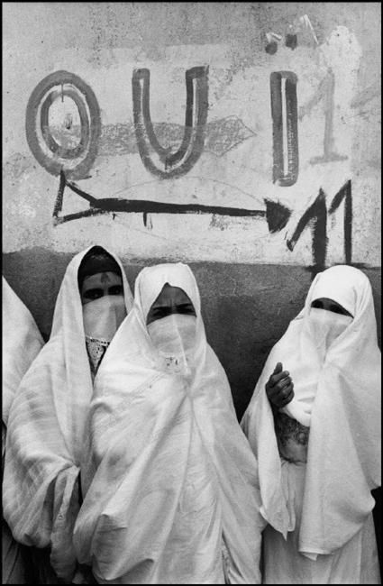 "Algiers. The conflict with France and Algeria has lasted for 8 years, splitting the French Colonial powers who wanted to retain an ""Algerie Francaise"" and the local population led by the FLN (National Liberation Front) who demanded independence. Veiled women going to the voting stations..."