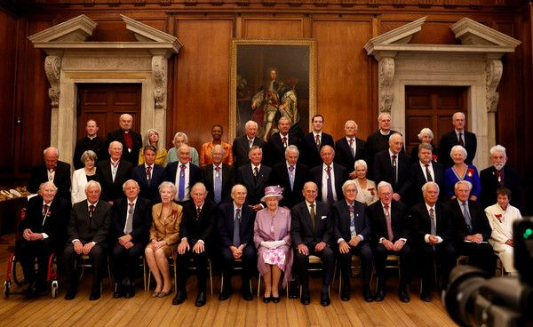 Queen Elizabeth II Photos Photos - Queen Elizabeth II (front C) sits next to Prince Philip, Duke of Edinburgh (front CR) during an official photograph with Companions of Honour after a reception in celebration of the centenary of the Order of the Companions of Honour at Hampton Court Palace on June 13, 2017 in London, England. - The Queen & Duke of Edinburgh Attend Evensong in Celebration of the Centenary of the Order of the Companions of Honour