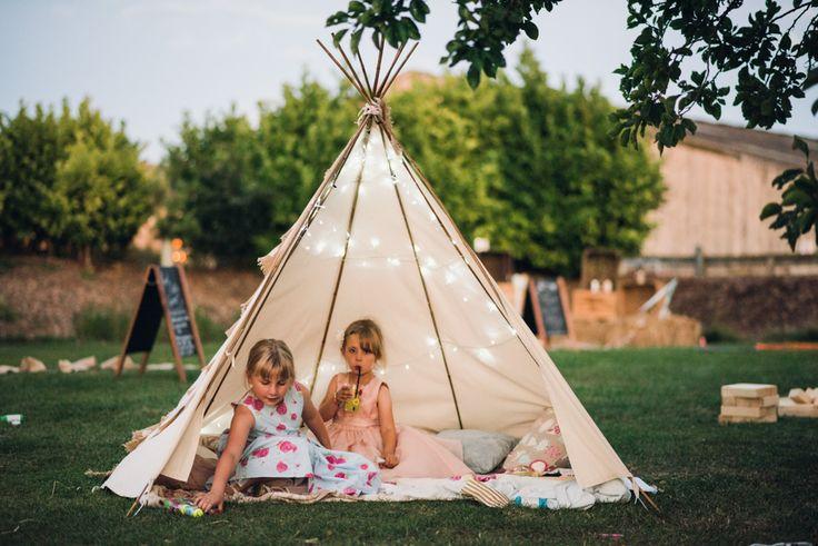 Children's TeePee - Photography by Cat Lane Weddings | Lace Justin Alexander Wedding Dress | Outdoor Wedding at Furtho Manor Farm | Peach Flowers | Monsoon Bridesmaid Dresses