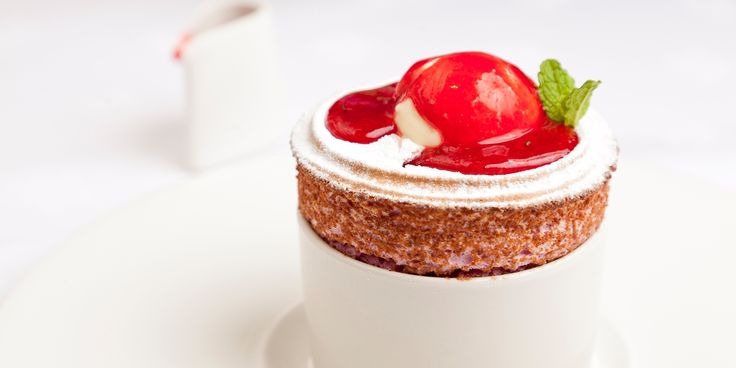 George Blogg's spectacular raspberry soufflé recipe is served with a creamy buttermilk ice cream and punchy raspberry and mint coulis