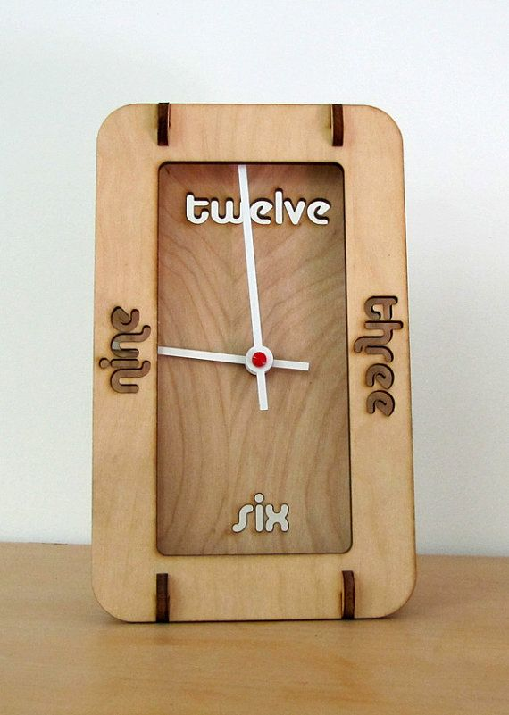 """Slot together desk clock made from unfinished 1/4"""" birch plywood. The clock uses a AA battery powered quartz movement. 8"""" tall x 5"""" wide x 3"""" deep"""