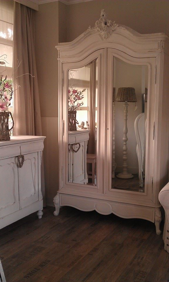 Shabby Chic in a rococo style. Find centerpieces similar to the one shown on this armoire at www.buycarvings.com
