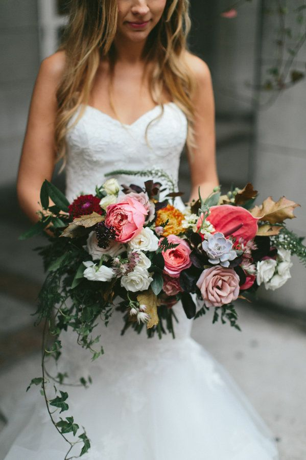 Urban chic overflowing bouquet: http://www.stylemepretty.com/canada-weddings/ontario/toronto/2016/02/15/urban-chic-organic-inspired-toronto-wedding/ | Photography: Brandon Scott - http://brandonscottphotography.com/
