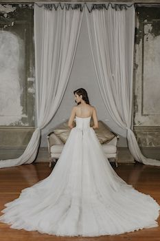 Zarina  Silhouette: Ball gown Neckline: Sweetheart Sleeve: Strapless Decoration: Lace applique and tulle skirt Train: 1.6m
