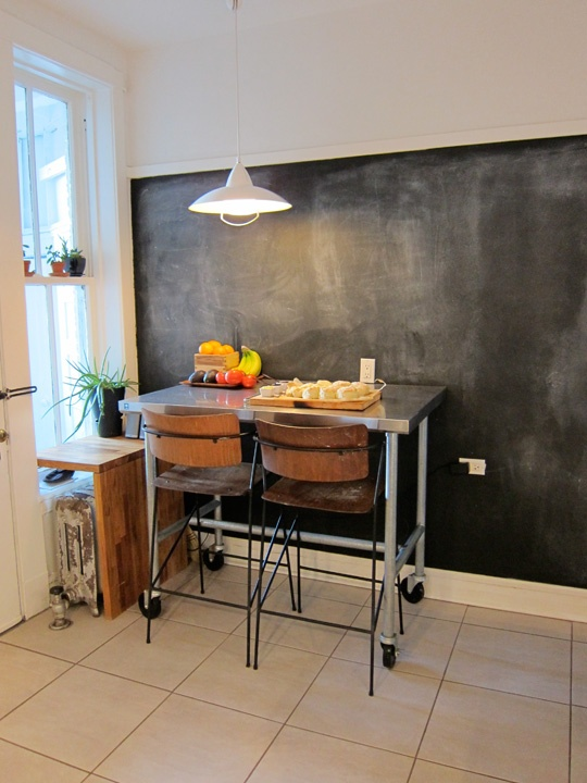 Chalkboard wall, table built around the vintage radiator, pendant...the list goes on!