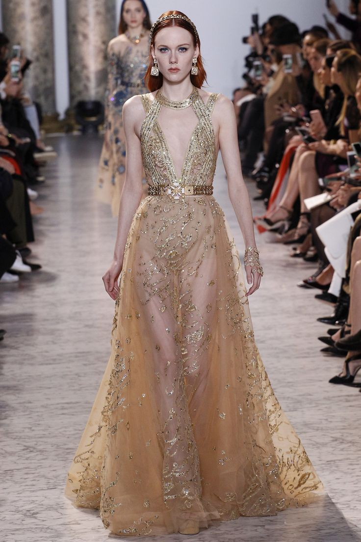 Elie Saab Spring 2017 Couture: Gorgeous gold gown with intricate bead work. I like the neckline detail!