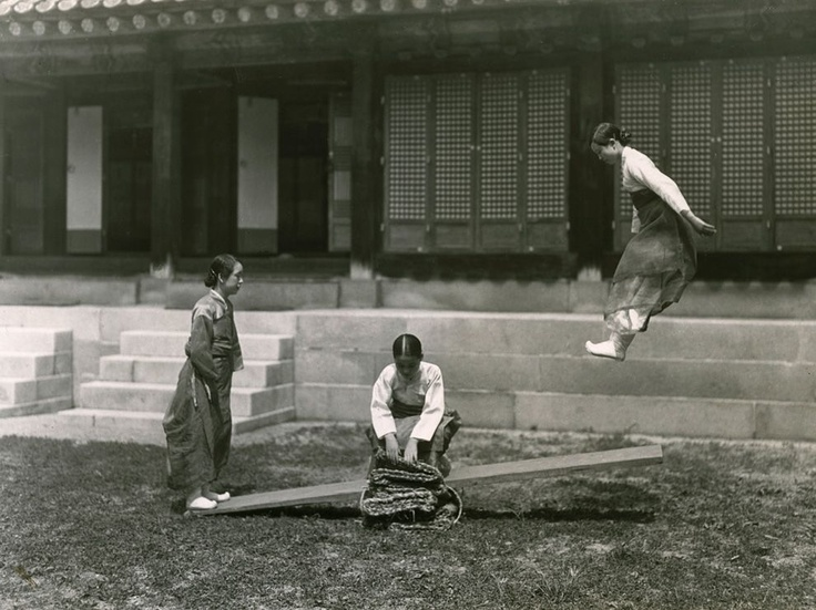 Seesaw, Korea    Photograph by W. Robert Moore, National Geographic