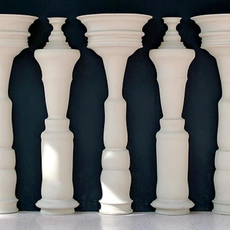 Represents: Gestalt Principle of Figure/Ground. This room makes your eyes group the columns (figures) and the people between the columns (ground). They way they are arranged make you see four people. Very interesting!