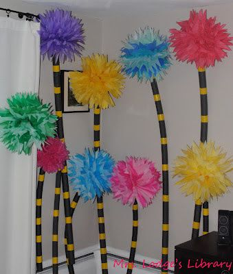 Dr. Seuss trees.  Swimming pool noodles or foam tubing and tissue paper, tulle or boa Pom poms. Bailing wire to bend tree into desired shape.