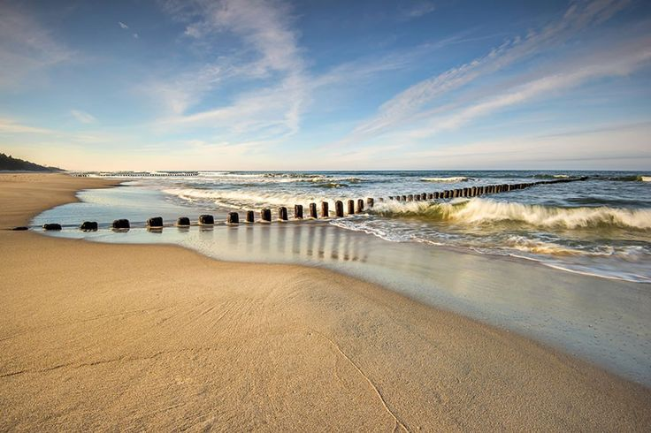 Vlies fotobehang Verlaten strand - Strand behang | Muurmode.nl