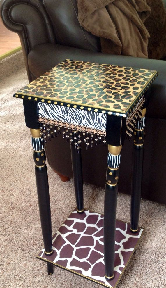 This hand painted table is perfect for the animal print enthusiast. Or for anyone that wants to add some zing to a room. Animal prints are all over the place in fashion and design. Look in any clothing or furniture store, and you are sure to find animal prints and fur (maybe thats my next table). This piece measures 12 x 12 x 28 and is done in such neutral tones, that it would match most decors. If interested, I can usually get this table in a 14x14x28 size. Just contact me.   I can paint…