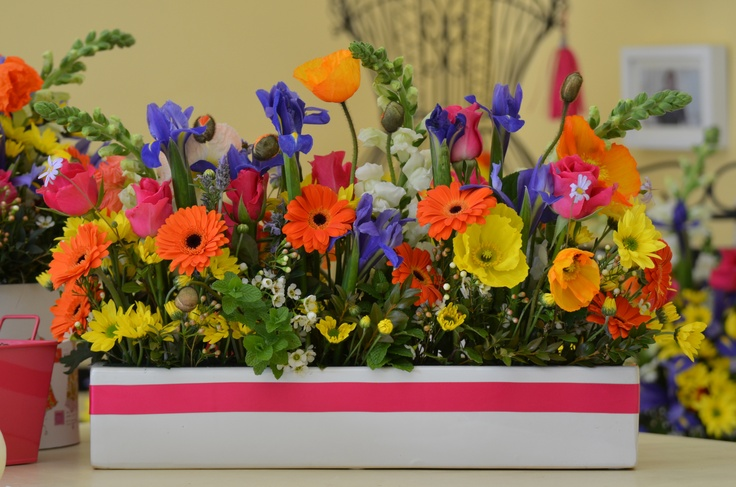 This trough of flowers looked like the flowers were dug from the garden and transplanted into the house