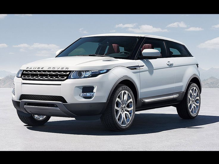 Land Rover Evoque Turbo Pure-4door in the color white w/black & Red interior fully loaded features/equipment.