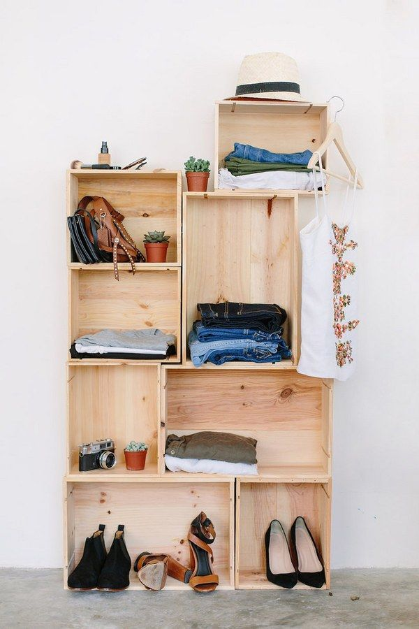 Stacking boxes on top of each other creates vignettes for all your shoes, bags, and jewelry that need a moment.