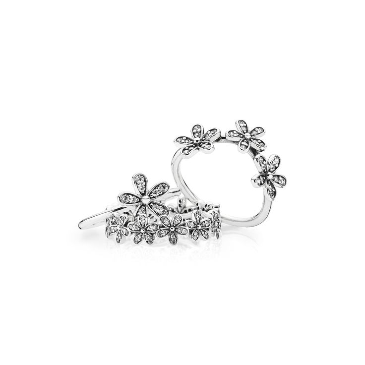 Dazzling daisy rings from PANDORA's Spring collection 2015. Perfect for stacking. #PANDORAring