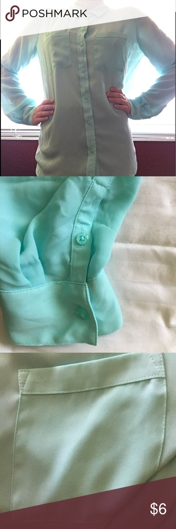 LIGHT MINT GREEN BUTTON DOWN LONG SLEEVE SHIRT Lovely sheer mint green button down long sleeve blouse. Super cute, light, and comfortable. It has a nice collar. The material is very thin and pretty see through. All of the buttons are intact and the two breast pockets are real pockets. The shirt is in great condition- like new. I only wore it once because it was too big for me. Great with black leggings. Apt. 9 Tops Button Down Shirts