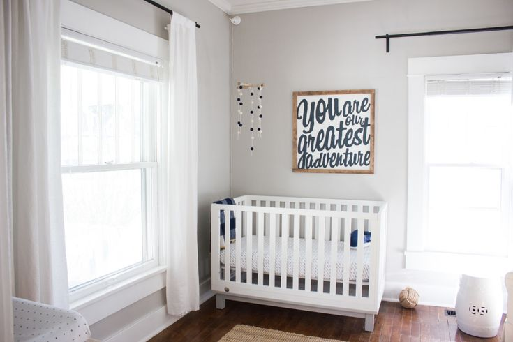 White, simple, adventure nursery for a boy or a girls - You can't go wrong!