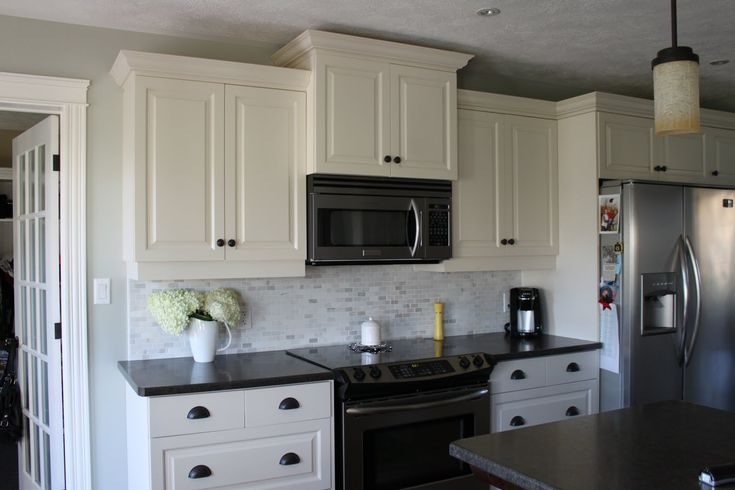 antique white kitchen cabinets with black appliances, White cabinets with gray backsplash Kitchen Ideas