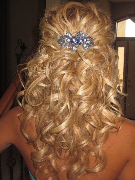 Half pulled back curly hair, that's basically what I'm looking to do. Though it depends on how the back of the dress I choose is. I sort of want a backless one to pull this hair off.