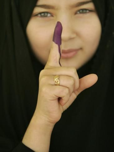 Young Girl Shows Her Inked Finger, Even Though She Was Too Young to Vote, in Karbala, Iraq Photographic Print at AllPosters.com
