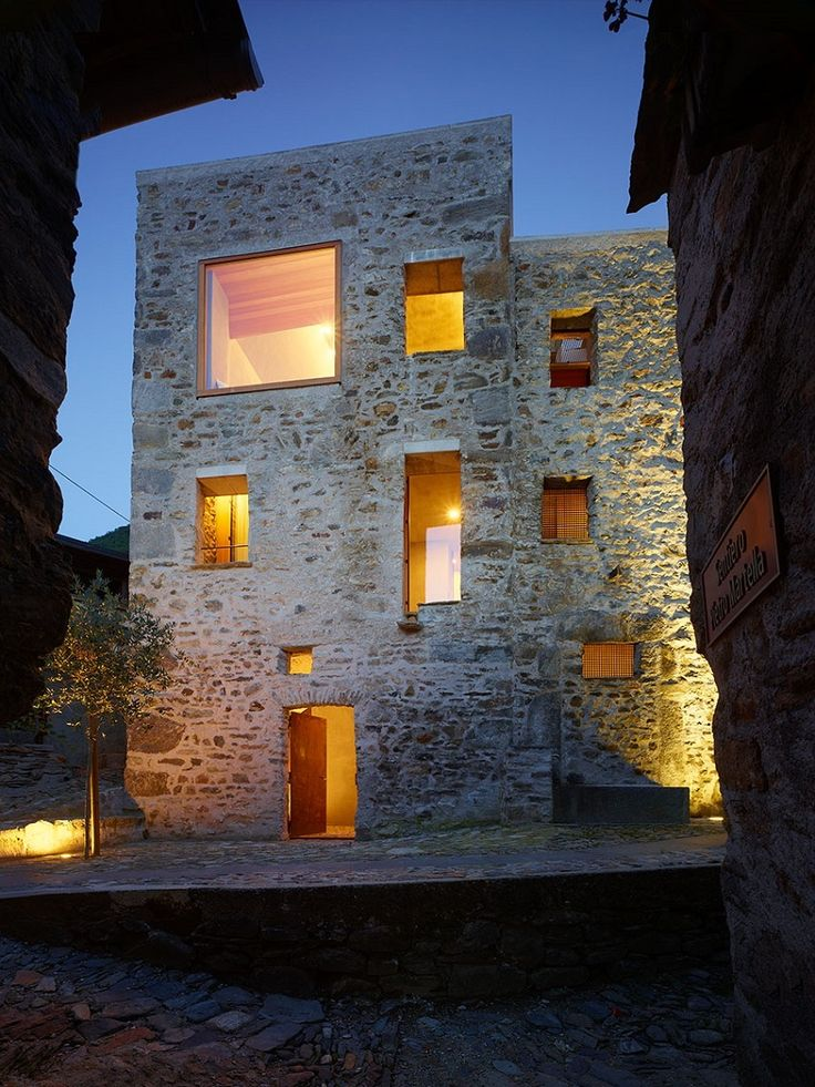 The renovation of this old stone structure by Wespi de Meuron Romeo architects was, at times, as much archeology as architecture. The small square in front of the building, the only in the village of Scaiano, dates the building, a former brandy distillery fortified with both spiritis and stone walls. After reinforcing the roof and replacing the wood beam floors with concrete, the team started to dig in.