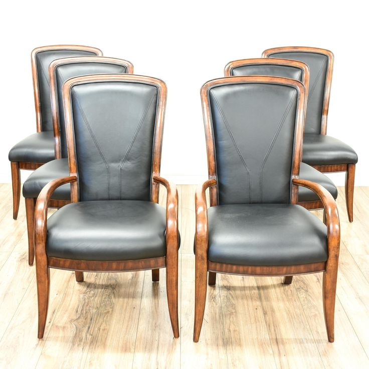 This set of 6 dining chairs are featured in a solid wood with a gorgeous glossy walnut finish. These sleek accent chairs have comfortable black leather upholstered cushions with delicate curved legs and backs. Perfect for formal dining in a modern space! #contemporary #chairs #diningchair #sandiegovintage #vintagefurniture