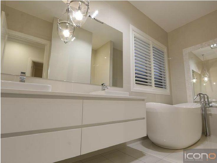 Stunning white bathroom! #iconobuildingdesign #whitebathroom #modern