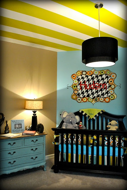If I ever have a boy, I love this nursery. Retro circles and houndstooth=PERECT. Love the vintage paint on the dresser as well.