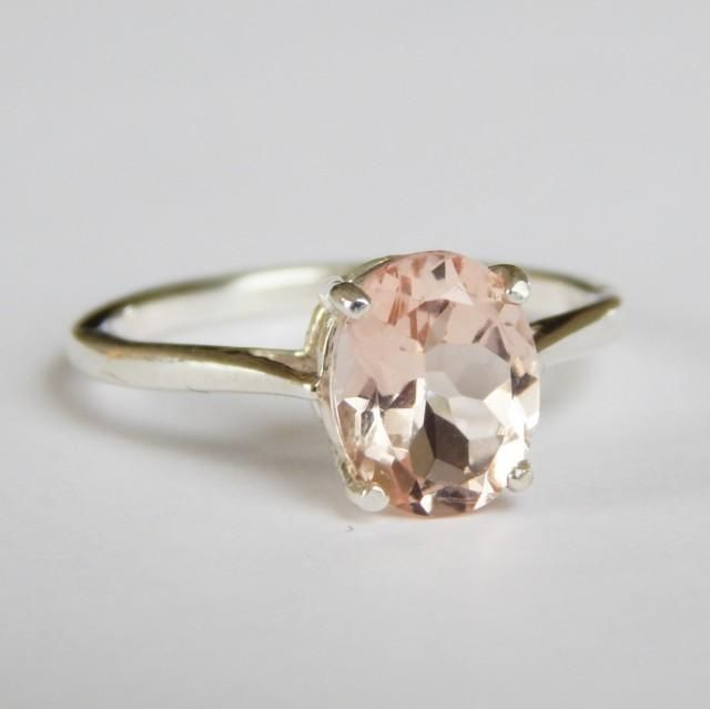 La Bella Pink Emerald (Morganite) Engagement Ring by La Bella BohemeBeautiful pale pink morganite set in your choice of sterling silver or 14k gold.* Natural morganite (pink beryl)* 1.45 - 1.55 average carat weight* 9mm x 7mm* Pale pink/blush color* Unenhanced* Available in whole and half sizes 4 - 11* Set in solid 0.925 sterling silver or 14k gold* All of my jewelry is made with 100% guaranteed natural and authentic precious and semiprecious gemstonesLa Bella Boheme designs are...