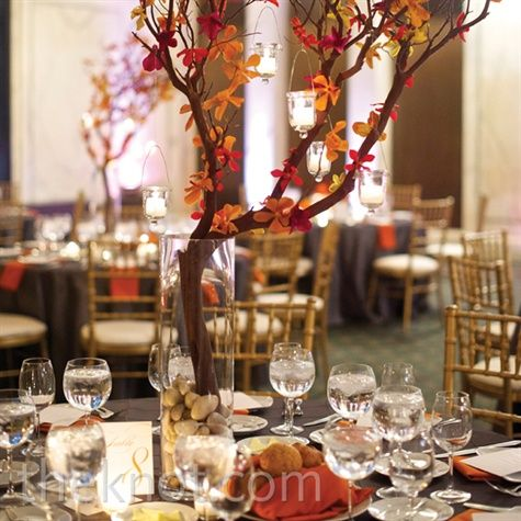 Some of the dinner tables got a boost in height from tall manzanita branches covered in orange orchid blooms and hanging candles.