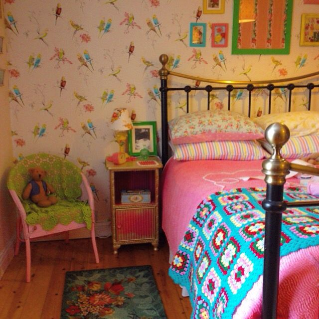 My colourful bedroom. The Lloyd Loom bedside table i restored. Took an age but i'm pleased with results. @sarahmaguire_myvintagehome