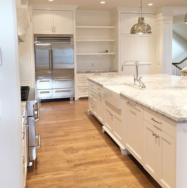 Kitchen with super white quartzite. This countertop looks like carrara marble but it's more durable than marble. Marble-looking Countertop. #superwhitequartzite Caitlin Creer Interiors.