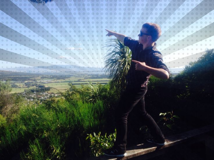 Jordan Just pointing out at the sky with a watermark on the photo to make the sky look cooler