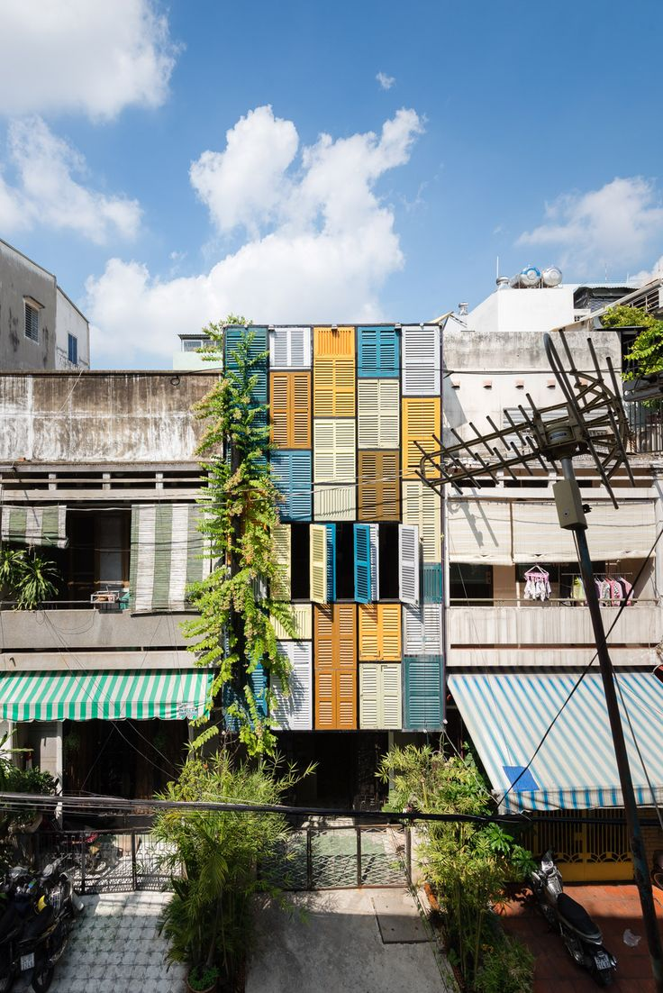 Built by Block Architects in Ho Chi Minh City, Vietnam with date 2014. Images by Quang Tran. This house was in an old terrace next to an apartment built in 1965. The owner works in travel and tourism, he once r...
