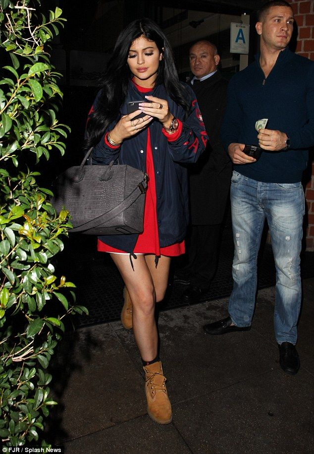 Kylie Jenner teams edgy bomber jacket with red shirt dress #dailymail