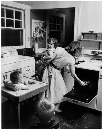Elliott Erwitt - Normal Chaos, 1955. S)  Moms 'multi-tasked' before the word even came into usage!!