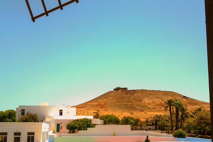 Taken from the windmill at the edge of the market area of Teuise, Lanzarote looking up to the castle of Santa Barbara. View my blog at, www.colingreenphotography.blogspot.co.uk.  Picture Copyright © 2017 Colin Green All Rights Reserved