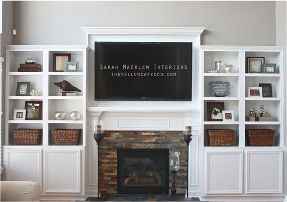 The addition of built in bookcases provides the added benefit of display for decorative objects.  We've used a variation of this in our own family room, using one bookcase to the side for the television.
