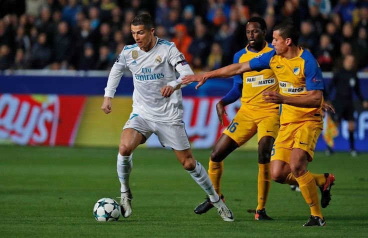 Cristiano Ronaldo Photos - Real Madrid's Portuguese forward Cristiano Ronaldo (L) is marked by Apoel's Brazilian midfielder Vinicius (C) and Apoel's Spanish midfielder Jesus Rueda (R) during the UEFA Champions League Group H match between Apoel FC and Real Madrid on November 21, 2017, in the Cypriot capital Nicosia's GSP Stadium.  / AFP PHOTO / Thomas COEX - APOEL Nikosia v Real Madrid - UEFA Champions League