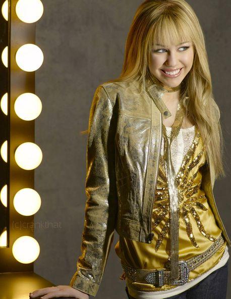 Miley Cyrus as Hannah Montana    white shirt, gold embellished deep v-neck tank top, gold belt, gold moto jacket, black skinny jeans