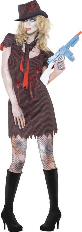 Déguisement zombie gangster sexy femme Halloween : Ce déguisement de zombie gangster sexy pour femme se compose d'une robe, d'une cravate et d'un chapeau (mitraillette, collants et bottes non inclus).La robe de couleur...