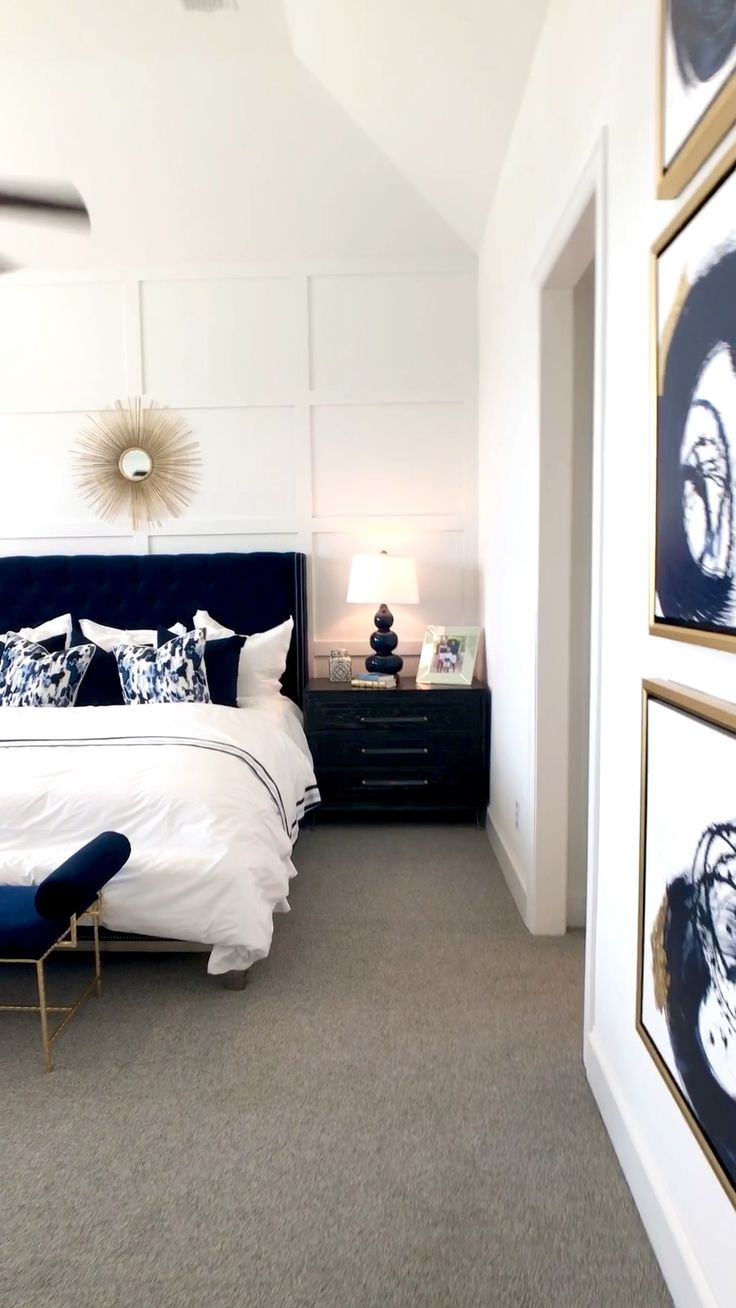 Bedroom With Navy Tufted Bed White Focal Wall With
