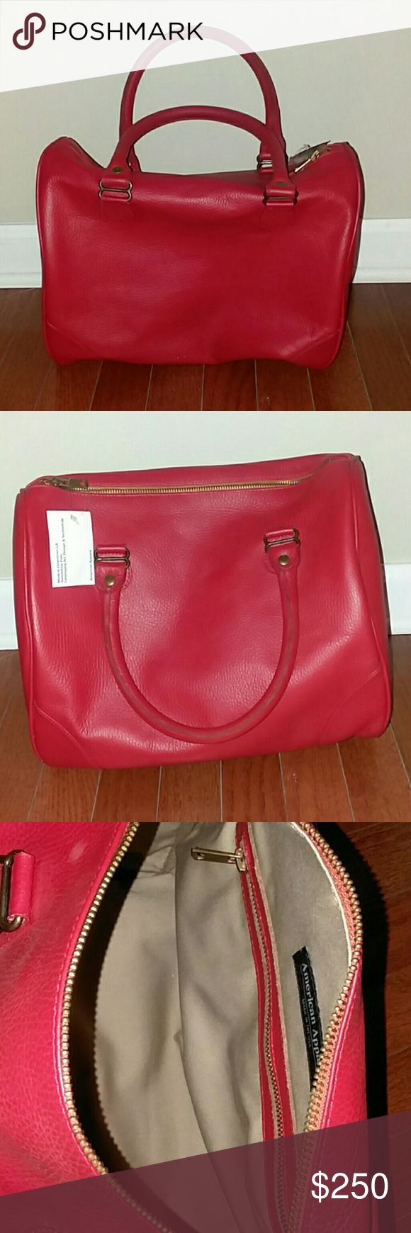 American Apparel red leather shoulder handbag. American Apparel red  leather handbag made in the USA.  New with tags. There are a few white dots on the purse,  not really noticeable but a close up is added in the picture section. Looks like paint  chip from sitting on the shelf.  Not sure if it'll come out or not. So know this before purchasing. American Apparel Bags