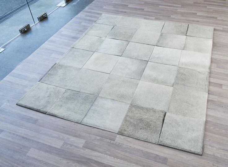 Designer patchwork sewn cowhide rug using 30cm squares of cowhide rug