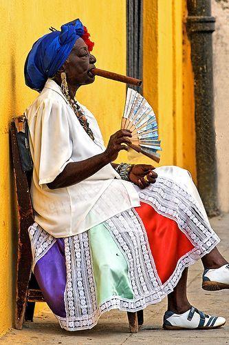 A cigar smoking woman somewhere in Havana, Cuba http://propertyforsalehavana.com/wp/