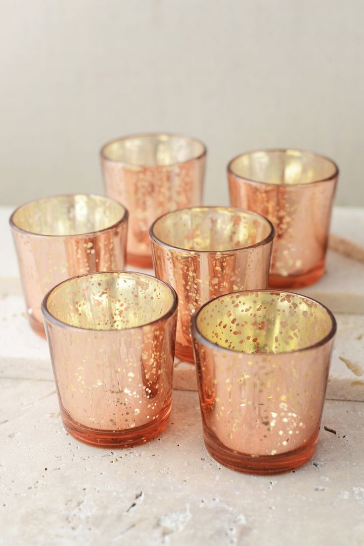 We could spray basic votive holders rose gold, inside and out. Or rose gold inside, light blue or ivory outside.