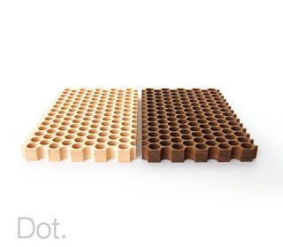 Dot.  Wooden trivet for hot pots.