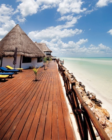 Isla Holbox, Mexico - The Plan Las Nubes de Holbox hotel offers end-of-the-road privacy, grab-and-go bikes, and a huge terrace crying out for sunset mojitos. Warm, shallow water and steady breezes...  www.liberatingdivineconsciousness.com