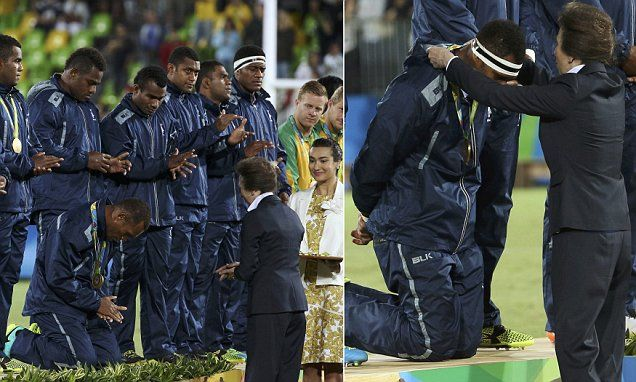 Fijian rugby gold medallists kneel respectfully for Princess Anne -    Fiji's rugby players have shown Britain's Princess Anne the deepest respect during their award ceremony after they walked away with the nation's fi...